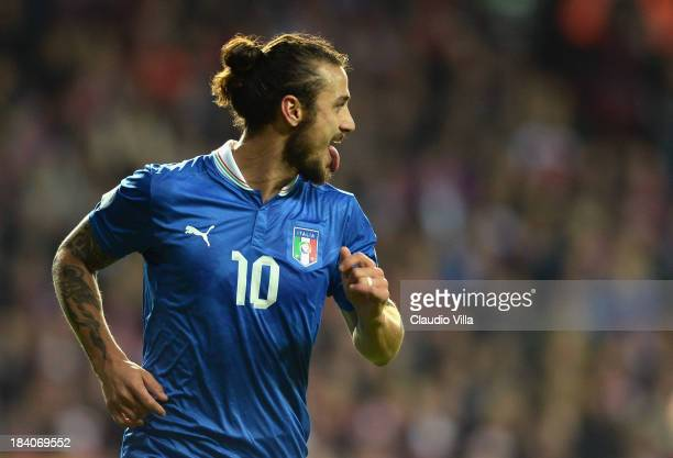 Pablo Daniel Osvaldo of Italy celebrates after scoring the opening goal of the FIFA 2014 World Cup qualifier between Denmark and Italy on October 11...