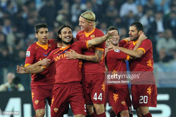 Pablo Daniel Osvaldo of Roma celebrates after scoring the opening goal during the Serie A match between SS Lazio and AS Roma at Stadio Olimpico on...