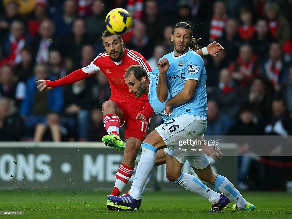 <a gi-track='captionPersonalityLinkClicked' href=/galleries/search?phrase=Pablo+Daniel+Osvaldo&family=editorial&specificpeople=4607628 ng-click='$event.stopPropagation()'>Pablo Daniel Osvaldo</a> of Southampton shoots to score the equalising goal during the Barclays Premier League match between Southampton and Manchester City at St Mary's Stadium on December 7, 2013 in Southampton, England.