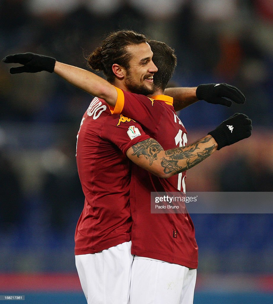 Pablo Daniel Osvaldo (L) with his teammate Miralem Pjanic of AS Roma celebrate after scoring this second team's goal during the TIM Cup match between AS Roma and Atalanta BC at Olimpico Stadium on December 11, 2012 in Rome, Italy.