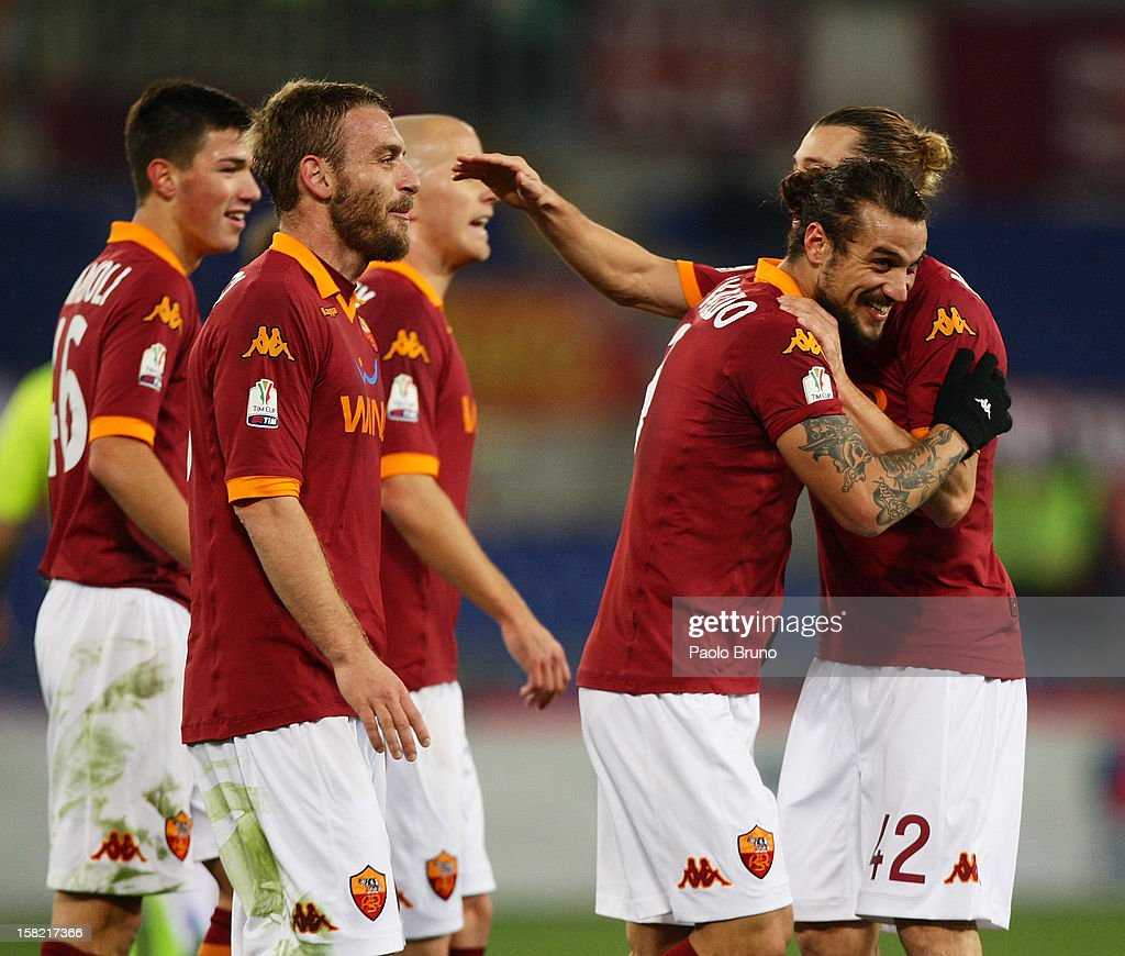 Pablo Daniel Osvaldo (2nd-R) with his teammates of AS Roma celebrate after scoring his second team's goal during the TIM Cup match between AS Roma and Atalanta BC at Olimpico Stadium on December 11, 2012 in Rome, Italy.