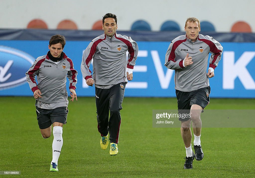 Pablo Daniel Piatti, Antonio Barragan and Jeremy Mathieu of Valencia warm up during a training session on the eve of the Champions League match between Paris Saint Germain FC and Valencia CF at the Parc des Princes stadium on March 5, 2013 in Paris, France.