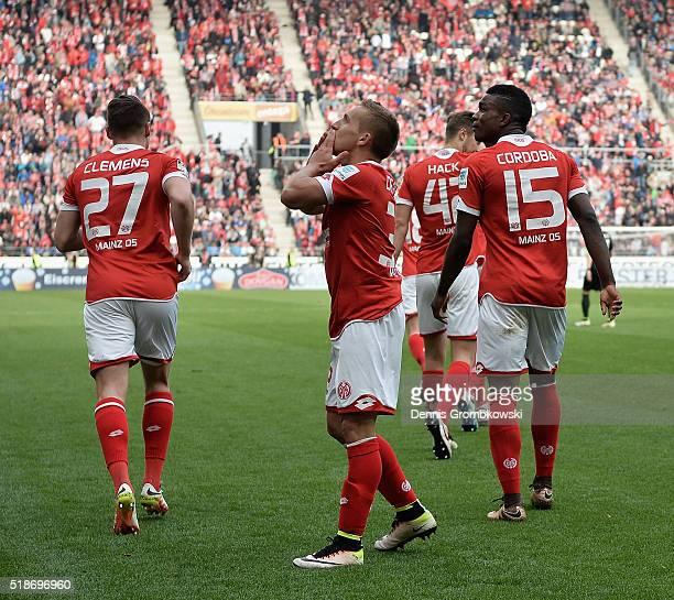 Pablo De Blasis of 1 FSV Mainz 05 celebrates with team mates as he scores their third goal during the Bundesliga match between 1 FSV Mainz 05 and FC...