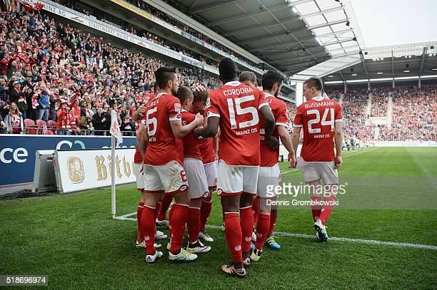 Pablo De Blasis of 1 FSV Mainz 05 celebrates with team mates as he scores their third goal during the Bundesliga match between 1 FSV Mainz 05 and FC...