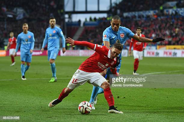 Pablo De Blasis of 1 FSV Mainz 05 is challenged by Bamba Anderson of Eintracht Frankfurt during the Bundesliga match between 1 FSV Mainz 05 and...