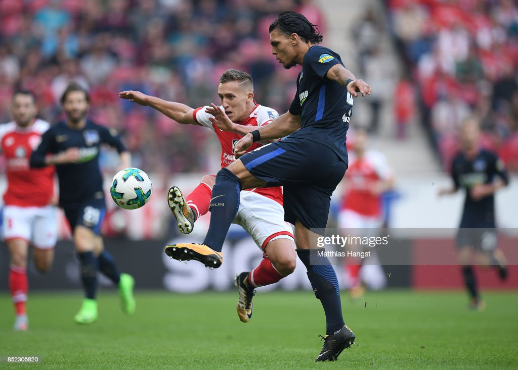 Pablo de Blasis of Mainz and Karim Rekik of Berlin compete for the ball during the Bundesliga match between 1. FSV Mainz 05 and Hertha BSC at Opel Arena on September 23, 2017 in Mainz, Germany.
