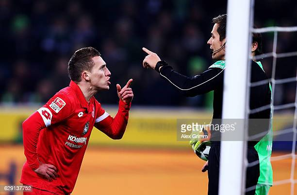 Pablo de Blasis of Mainz argues with referee Robert Hartmann after he scores the equalizing from an offside position during the Bundesliga match...