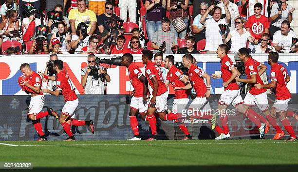 Pablo de Blasis of Mainz celebrates his team's first goal with team mates during the Bundesliga match between 1 FSV Mainz 05 and TSG 1899 Hoffenheim...