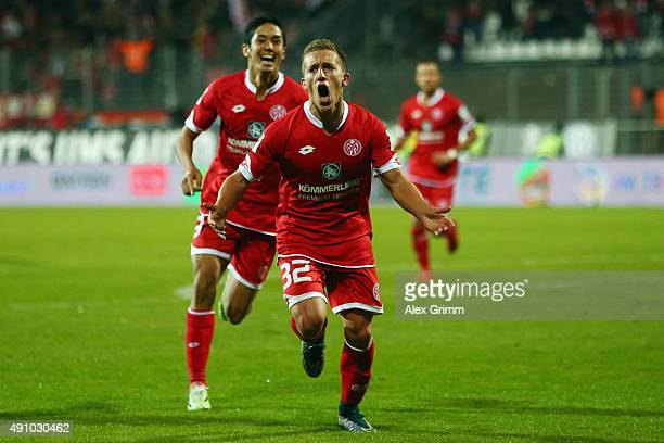 Pablo de Blasis of Mainz celebrates his team's third goal with team mate Yoshinori Muto during the Bundesliga match between SV Darmstadt 98 and 1FSV...