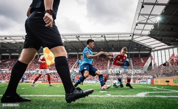 Pablo de Blasis of Mainz in action against Charles Aranguiz of Leverkusen during the Bundesliga match between 1 FSV Mainz 05 and Bayer 04 Leverkusen...