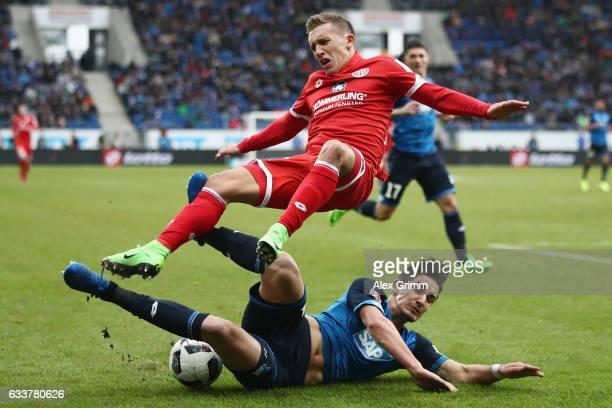 Pablo de Blasis of Mainz is challenged by Benjamin Huebner of Hoffenheim during the Bundesliga match between TSG 1899 Hoffenheim and 1 FSV Mainz 05...