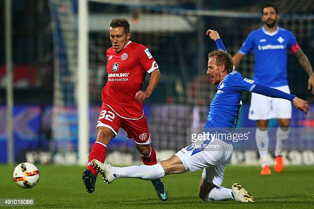 Pablo de Blasis of Mainz is challenged by Jan Rosenthal of Darmstadt during the Bundesliga match between SV Darmstadt 98 and 1FSV Mainz 05 at...