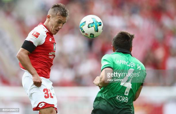 Pablo de Blasis of Mainz is challenged by Julian Korb of Hannover during the Bundesliga match between 1 FSV Mainz 05 and Hannover 96 at Opel Arena on...