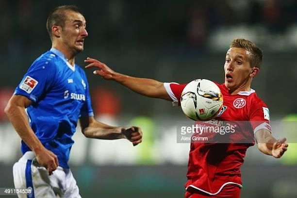 Pablo de Blasis of Mainz is challenged by Luca Caldirola of Darmstadt during the Bundesliga match between SV Darmstadt 98 and 1FSV Mainz 05 at...