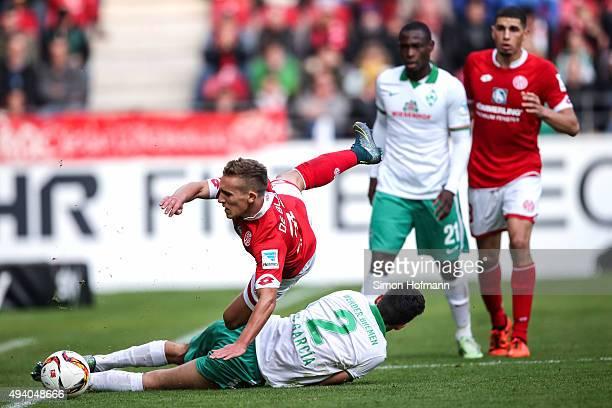 Pablo de Blasis of Mainz is challenged by Santiago Garcia of Bremen during the Bundesliga match between 1 FSV Mainz 05 and Werder Bremen at Coface...
