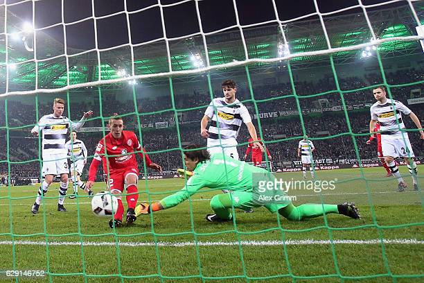 Pablo de Blasis of Mainz scores a disallowed goal past goalkeeper Yann Sommer of Moenchengladbach during the Bundesliga match between Borussia...