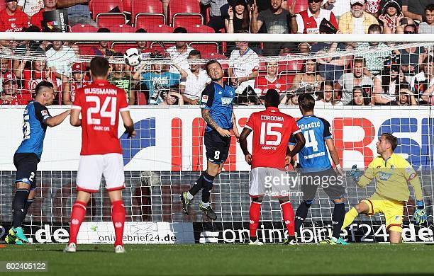 Pablo de Blasis of Mainz scores his team's first goal past goalkeeper Oliver Baumann of Hoffenheim during the Bundesliga match between 1 FSV Mainz 05...