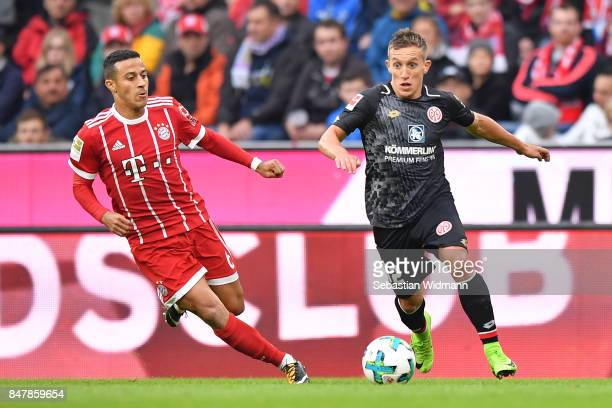 Pablo de Blasis of Mainz with Thiago Alcantara of Bayern Muenchen during the Bundesliga match between FC Bayern Muenchen and 1 FSV Mainz 05 at...