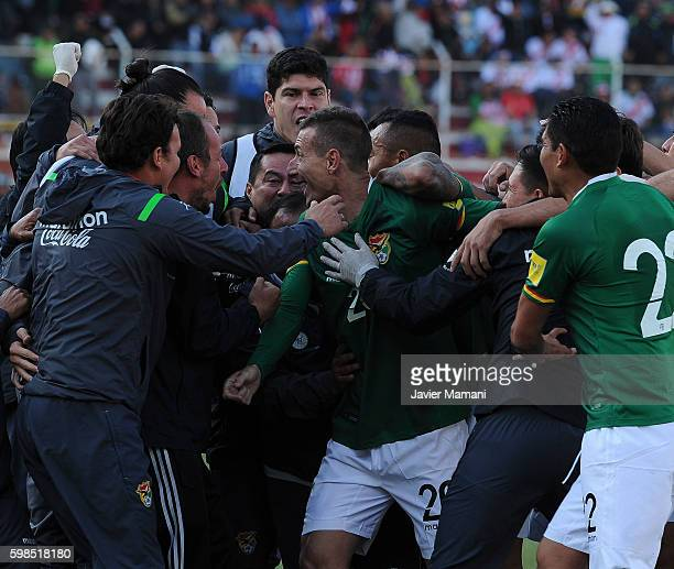 Pablo Escobar of Bolivia celebrates with his teammates after scoring the first goal of his team during a match between Bolivia and Peru as part of...