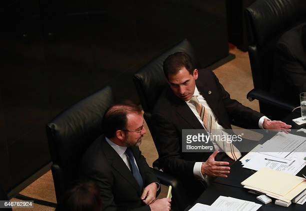Pablo Escudero president of the Senate right speaks with Luis Videgaray Mexico's foreign relations minister during a senate session in Mexico City...
