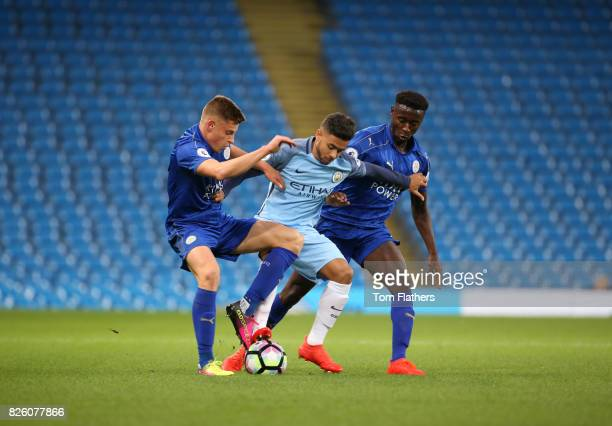 Pablo Fernandes of Manchester City is tackled by Harvey Barnes and Lamine Kaba Sherif of Leicester City
