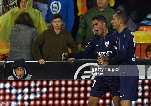 Pablo Fornals and Sergio Paulo Barbosa Duda celebrates their goal during the La Liga match between Valencia CF vs Malaga CF at Estadio de Mestalla on...