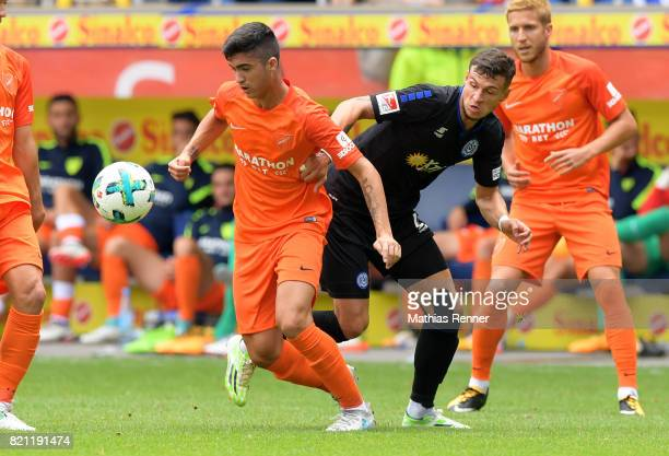 Pablo Fornals of FC Malaga and Thomas Blomeyer of MSV Duisburgwaehrend the game between MSV Duisburg and FC Malaga on july 23 2017 in Duisburg Germany