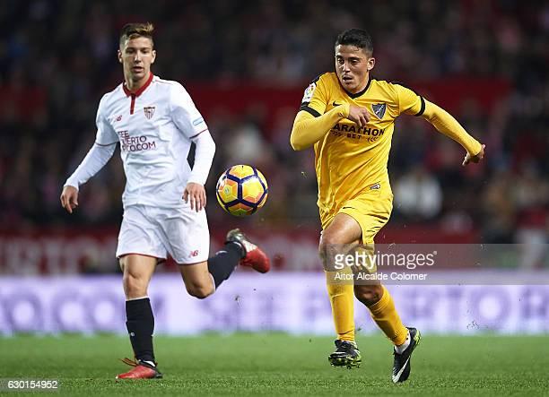 Pablo Fornals of Malaga CF being followed by Luciano Vietto of Sevilla FC during the La Liga match between Sevilla FC and Malaga CF at Estadio Ramon...