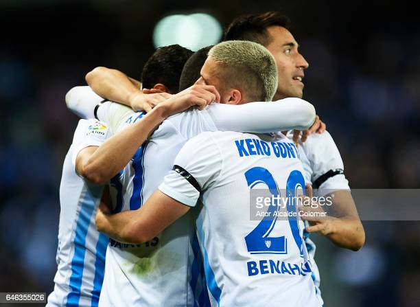 Pablo Fornals of Malaga CF celebrates after scoring the first goal of Malaga CF with his team mates during La Liga match between Malaga CF and Real...