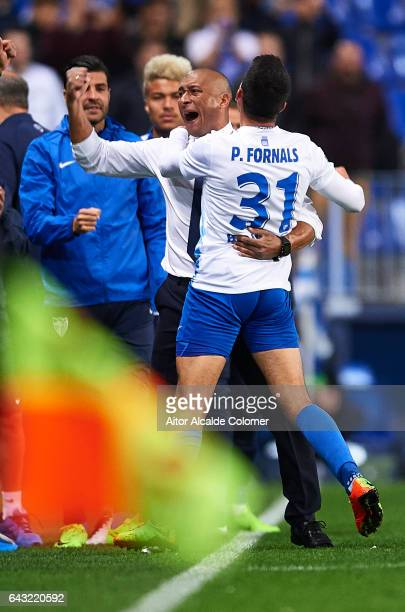 Pablo Fornals of Malaga CF celebrates after scoring with the head Coach of Malaga CF Marcelo Romero during La Liga match between Malaga CF and UD Las...