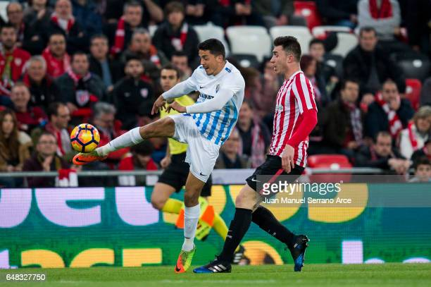 Pablo Fornals of Malaga CF competes for the ball with Aymeric Laporte of Athletic Club during the La Liga match between Athletic Club Bilbao and...