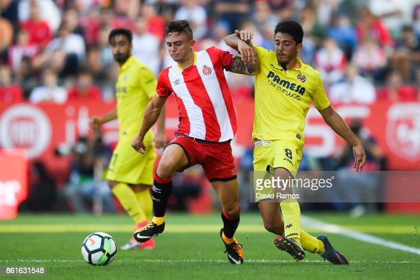 Pablo Fornals of Villarreal CF competes for the ball with Pablo Maffeo of Girona FC during the La Liga match between Girona and Villarreal at Estadi...