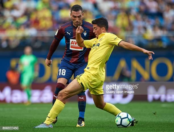 Pablo Fornals of Villarreal competes for the ball with Anaitz Arbilla of Eibar during the La Liga match between Villarreal and Eibar at Estadio De La...