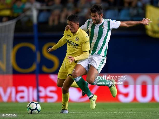 Pablo Fornals of Villarreal competes fot the ball with Antonio Barragan of Betis during the La Liga match between Villarreal CF and Real Betis at...