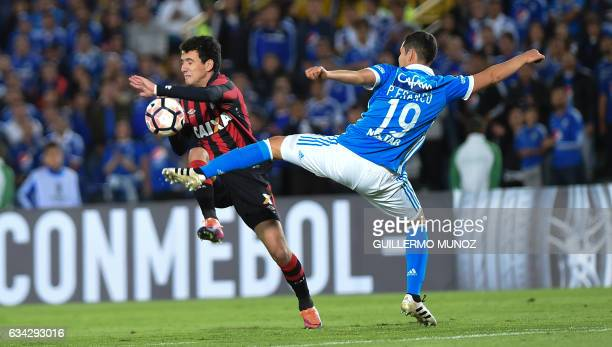 Pablo from Brazil's Atletico Paranaense vies for the ball with Pedro Camilo Franco from Colombia's Millonarios during the Copa Libertadores 2017...