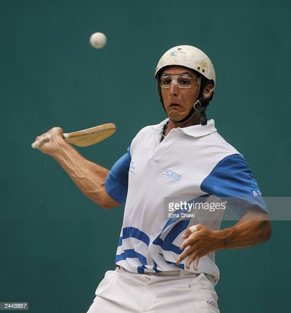 Pablo Fustos of Argentina returns a shot against Mexico during the pelota vasca doubles finals at Centro Olimpico Juan Pablo Durate on August 15 2003...