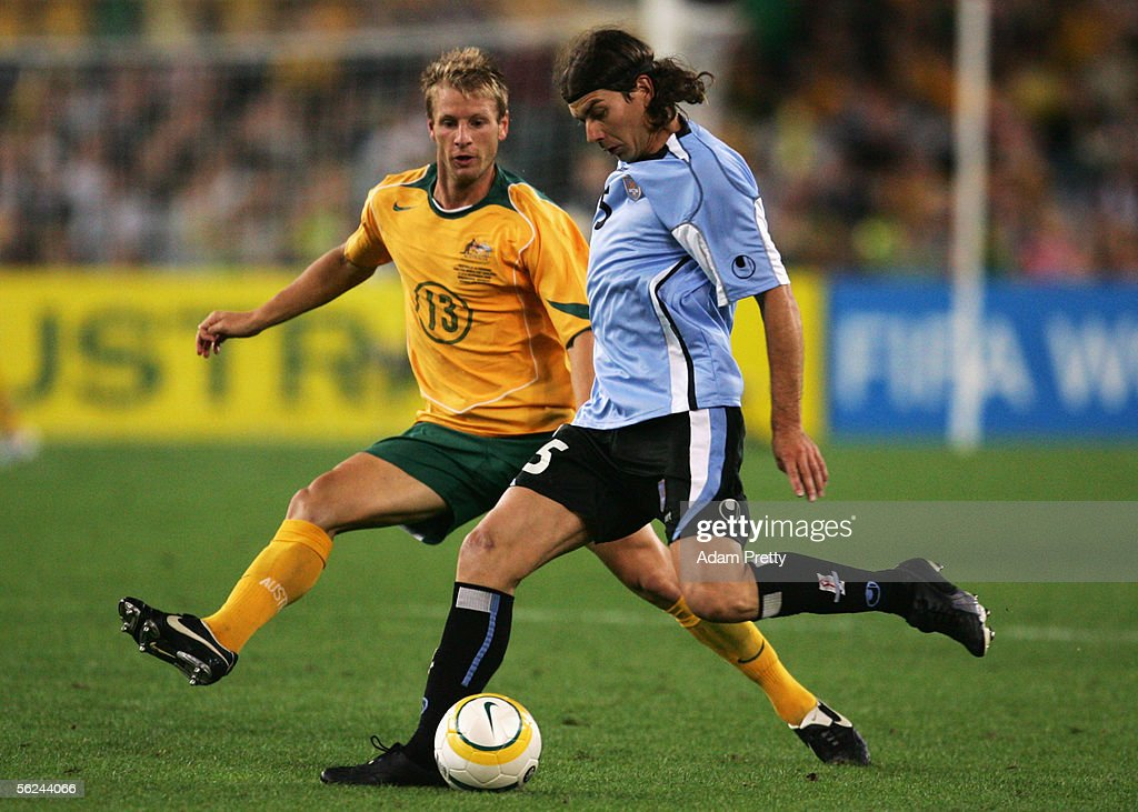 Pablo Garcia of Uruguay and Vince Grella of the Socceroos in action during the second leg of the 2006 FIFA World Cup qualifying match between Australia and Uruguay at Telstra Stadium November 16, 2005 in Sydney, Australia.