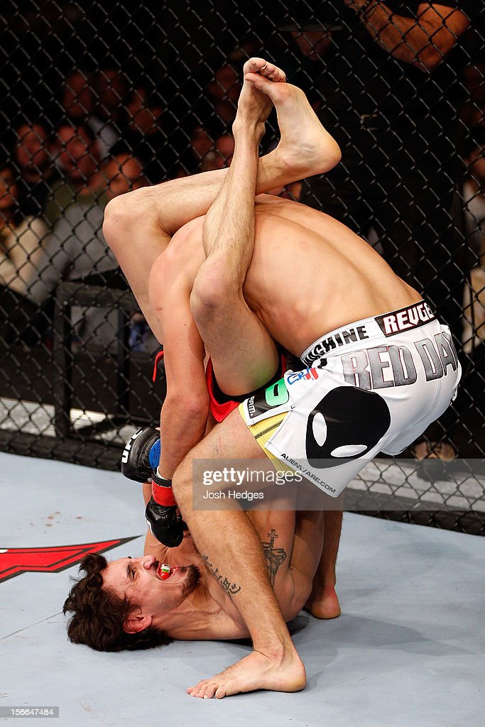Pablo Garza (L) grapples against <a gi-track='captionPersonalityLinkClicked' href=/galleries/search?phrase=Mark+Hominick&family=editorial&specificpeople=7201240 ng-click='$event.stopPropagation()'>Mark Hominick</a> in their featherweight bout during UFC 154 on November 17, 2012 at the Bell Centre in Montreal, Canada.