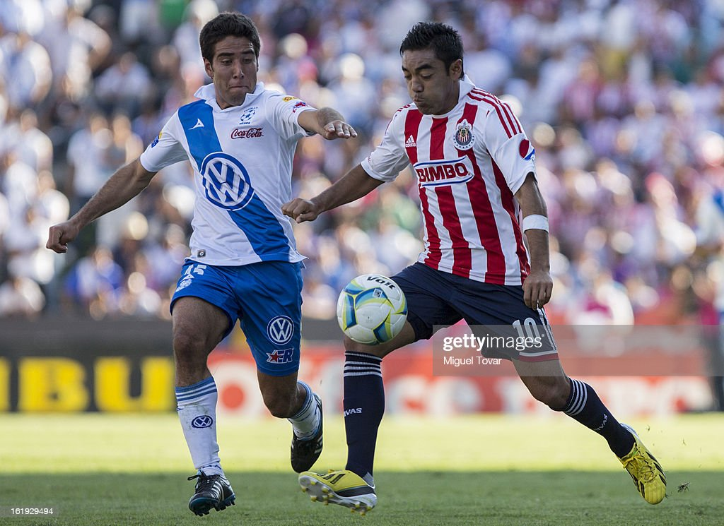 Pablo Gonzalez (L) of Puebla fights for the ball with Jorge Marco Fabian (R) of Chivas during a match between Puebla and Chivas as part of the Clausura 2013 at Cuauhtemoc Stadium on February 17, 2013 in Puebla, Mexico.