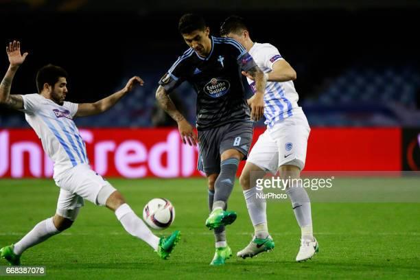Pablo Hernandez midfielder of Celta de Vigo battles for the ball with Alejandro Pozuelo midfielder of KRC Genk FC during the UEFA Europe League Round...