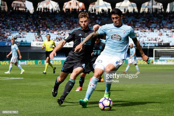 Pablo Hernandez midfielder of Celta de Vigo battles for the ball with Asier Illarramendi midfielder of Real Sociedad de Futbol during the La Liga...