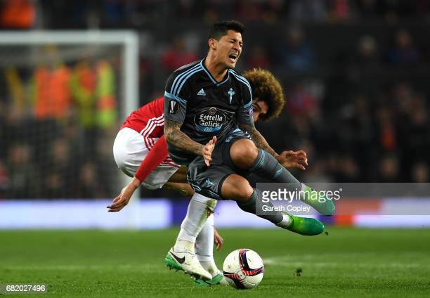 Pablo Hernandez of Celta Vigo is tackled by Marouane Fellaini of Manchester United during the UEFA Europa League semi final second leg match between...
