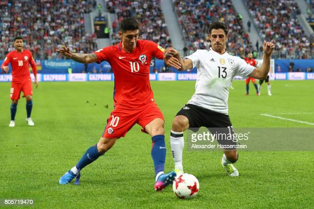 Pablo Hernandez of Chile and Lars Stindl of Germany battle for possession during the FIFA Confederations Cup Russia 2017 Final between Chile and...