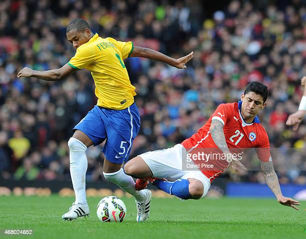 Pablo Hernandez of Chile is challenged by Fernandinho of Brazil during the International Friendly match between Brazil and Chile at Emirates Stadium...