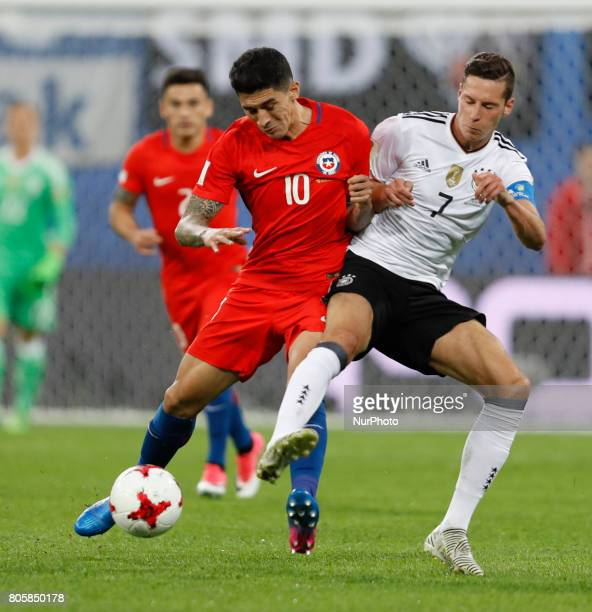 Pablo Hernandez of Chile national team and Julian Draxler of Germany national team vie for the ball during FIFA Confederations Cup Russia 2017 final...