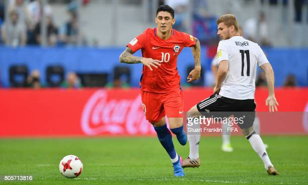 Pablo Hernandez of Chile takes the ball past Timo Werner of Germany during the FIFA Confederations Cup Russia 2017 Final between Chile and Germany at...