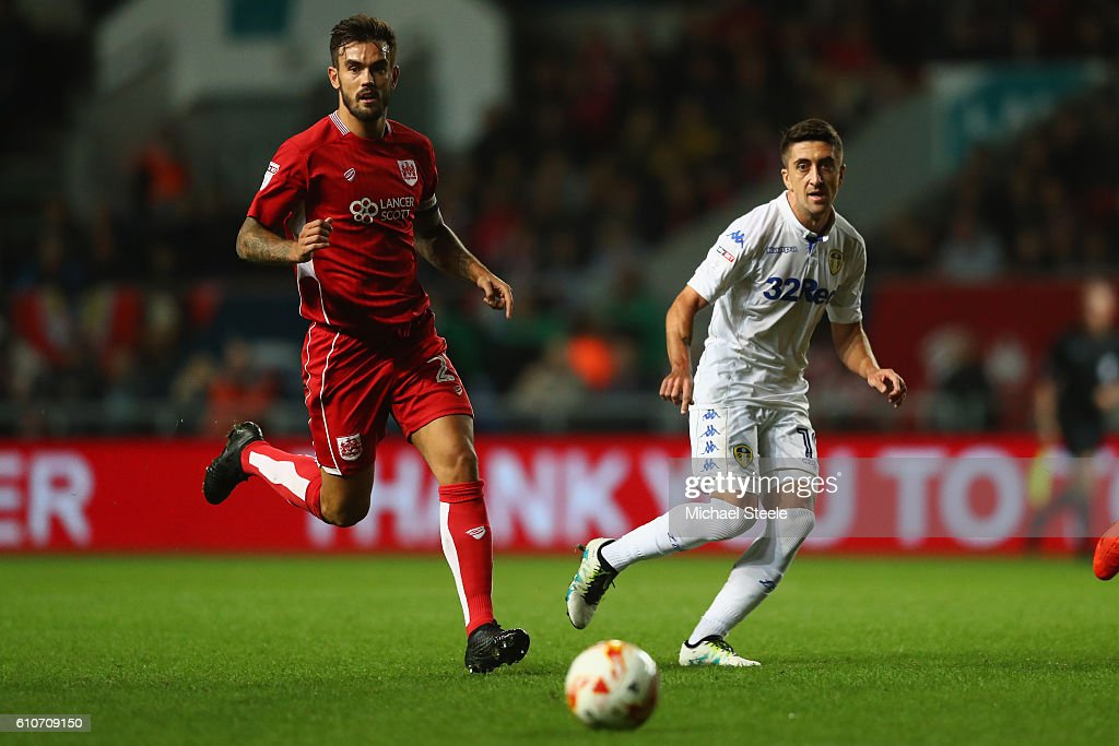 Pablo Hernandez (R) of Leeds United feeds a pass as Marlon Pack of Bristol City looks on during the Sky Bet Championship match between Bristol City and Leeds United at Ashton Gate on September 27, 2016 in Bristol, England.