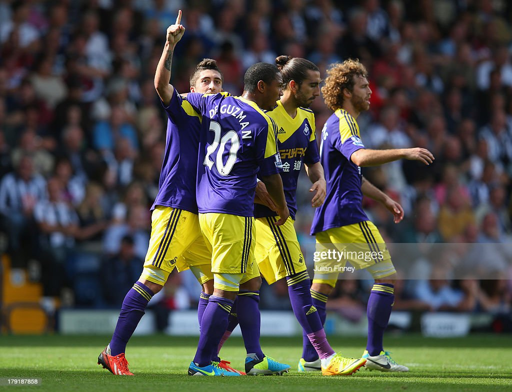 Pablo Hernandez of Swansea celebrates with team mates after scoring their second goal during the Barclays Premier League match between West Bromwich Albion and Swansea City at The Hawthorns on September 01, 2013 in West Bromwich, England.
