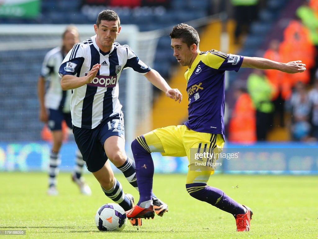 Pablo Hernandez of Swansea City is challenged by Graham Dorrans during the Barclays Premier League match between West Bromwich Albion and Swansea City at The Hawthorns on September 01, 2013 in West Bromwich, England.