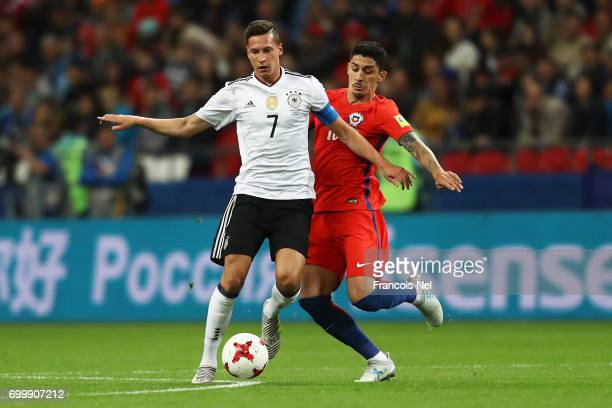 Pablo Hernandz of Chile tackles Julian Draxler of Germany during the FIFA Confederations Cup Russia 2017 Group B match between Germany and Chile at...